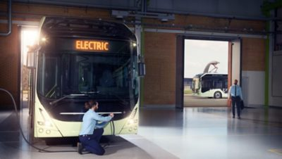 Electric Volvo bus recharging inside a bus depot