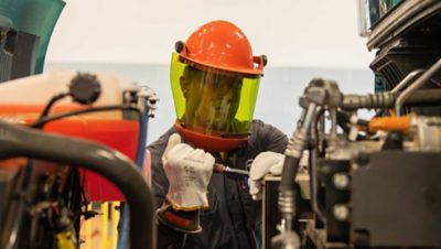 A trained technician wearing personal protective equipment