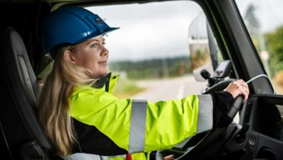 Ebba Bergbom Wallin, Electromobility Business Manager at Volvo Trucks, behind the wheel of the electric Volvo FMX.