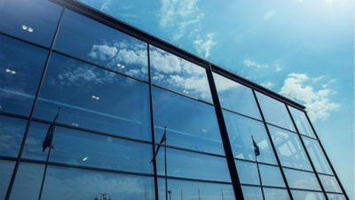 Volvo Group glass building reflecting the sky