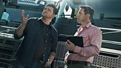 Salesman from a Volvo Group dealer speaking with a customer