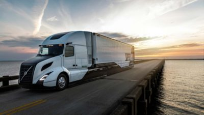 The Volvo Supertruck driving on a bridge in the sunset