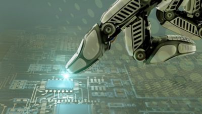 Robotic hand interacting with a motherboard