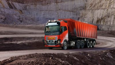 A red automated Volvo truck part of Volvo Group's first autonomous commercial solution in a lime stone pit mine in Norway,