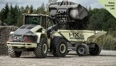 Concept prototype vehicles from Volvo: LX1, a hybrid wheel loader, & HX1, an autonomous, battery-electric loadcarrier