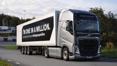 """Grey Volvo truck with the message """"I'm one in a million"""" on its payload on a road in Gothenburg, Sweden"""
