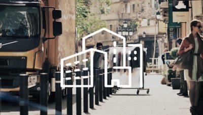 Biała ilustracja przedstawiająca miasto nałożona na zdjęcie dostawcy pchającego stojak z ubraniami tuż obok samochodu ciężarowego Volvo