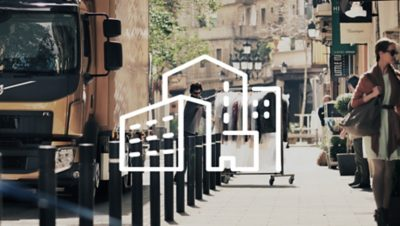 Une illustration blanche d'une ville sur un livreur poussant un rack de vêtements juste à côté d'un camion Volvo