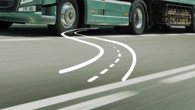 A white illustration of a serpntine road set over a green Volvo Group truck on the road