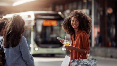 1860x1050-woman-at-bus-stop.jpg