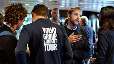 Volvo Group employees, representing the Volvo Group Academic Partner Porgram, speaking with students