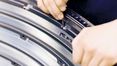 Volvo Materials Technology worker adjustning a metal part