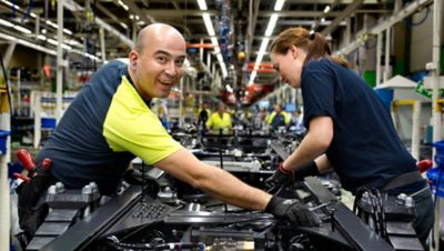 Two Volvo Group production workers in the Hagerstown factory