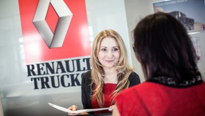 A Renault Trucks employee speaking with a customer
