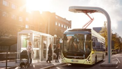 Future vision concept of a Volvo Group bus picking up passengers at a bus shelter