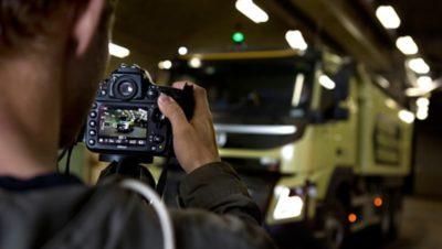 Photographer taking pictures of a Volvo Group truck