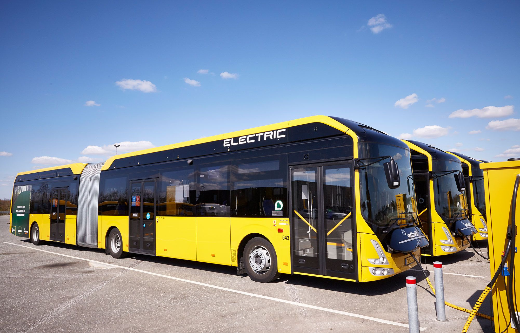 Yellow Volvo 7900 Electric Articulated when charging