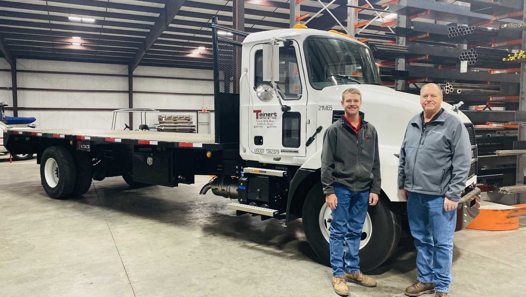 Mack Trucks' MD Series models are exceeding customer and dealer expectations for productivity and performance, resulting in strong order activity and driving increased interest in the medium-duty vehicles. Pictured on the left is Logan Teinert, fleet manager of Teinert Metals (left), and Randy Teinert, owner (right), who stand beside their first Mack® MD6, one of two in their fleet. The Mack MD6 pictured on the right is part of the leasing and rental fleet owned by Mack dealer TranSource Truck & Trailer Centers in Greensboro, North Carolina