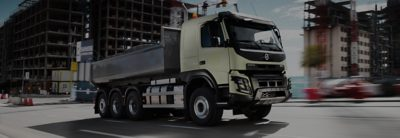 Volvo FMX side view on the road