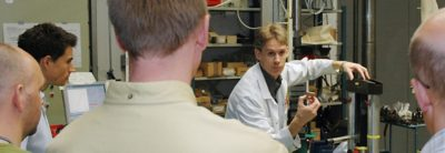 Teacher doing a demonstration for students in a Volvo Group Materials Technology Course