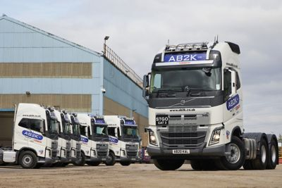 AB2K is upgrading its fleet with six new flagship Volvo FH16 750 Globetrotter XL tractor units. & John Murphy, Chief Executive of Quattro Group, with his new Volvo FH16 fleet.