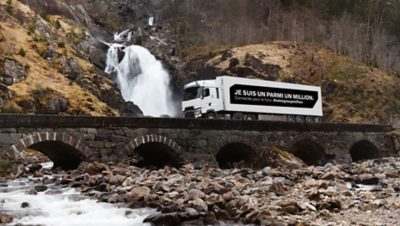 """White Renault truck with the message """"I'm one in a million"""" on its payload, driving on a bridge in Lyon, France"""