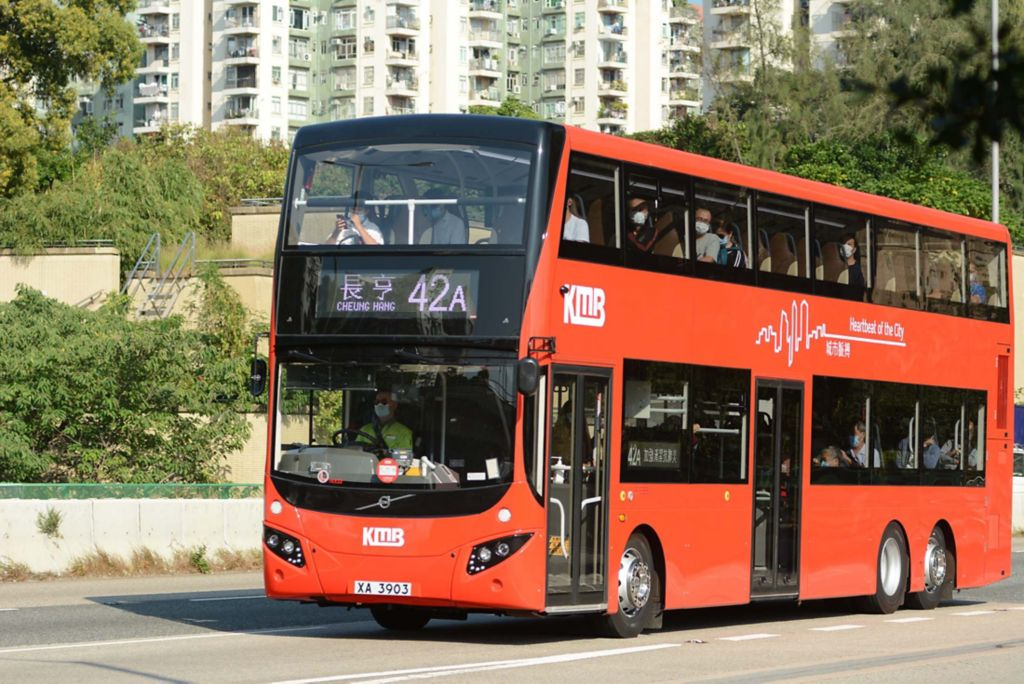 The Volvo B8L Double Decker  carrying commuters in Hong Kong