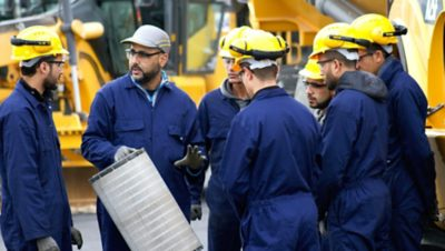 A teacher in Morocco shows his students a piece of machinery. The employment rate is 85% within nine months of graduation.