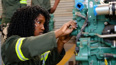 10% of the graduates are women, the goal is to increase that number. Here, a student in Zambia works on an engine.