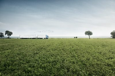 Volvo FH LNG driving along fields
