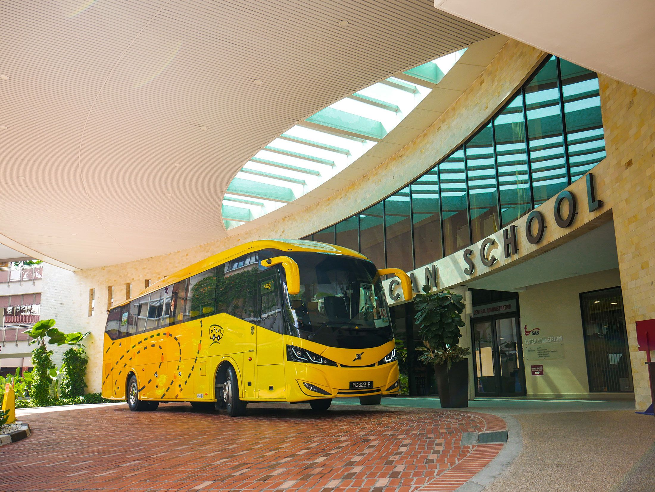 Volvo B7R coach parked outside a school in Singapore