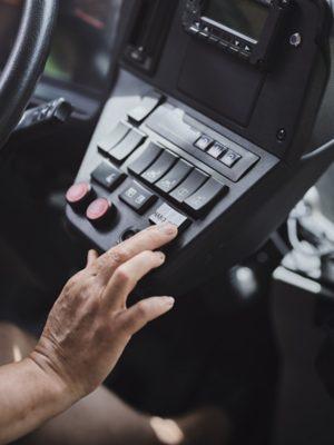 Hand-over button in an autonomous bus