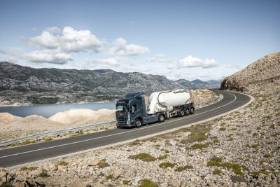 A truck drives down a curving slope