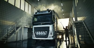 A truck being power washed