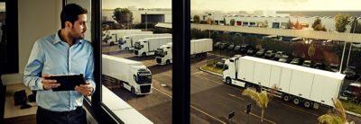Volvo FH fuel efficiency man looking at trucks