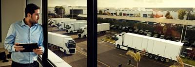Volvo FMX fuel efficiency man looking at trucks