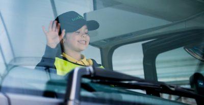 Volvo Trucks stop look wave smiling girl banner