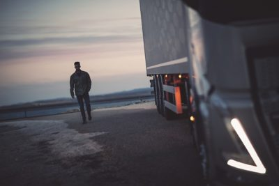 A man at sunset with a truck in the foreground