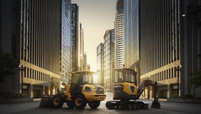 도로 작업 현장에서 굴착 작업 중인 노란색 Volvo Group 굴삭기