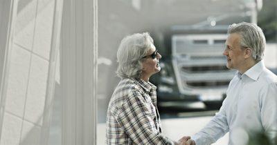 Volvo finance trucks handshake