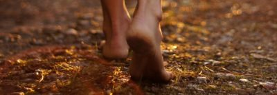 Bare feet walking on the ground.