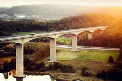 A full hybris bus drives across a bridge