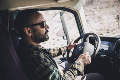 A confident driver drives uphill