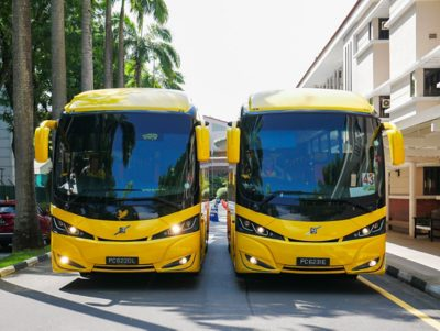 Two Volvo B7R buses alongside each other on the road