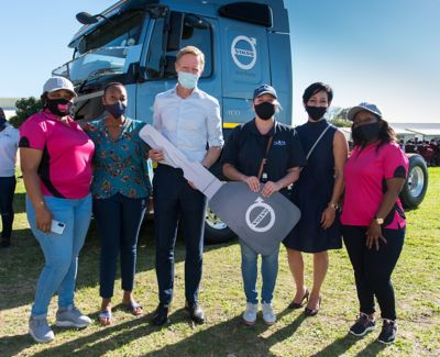 Two Volvo FMX trucks being handover to SOS NPO, present from Volvo is Onica Ndlovu, Used Trucks Director, Marcus Hörberg VP Volvo Group Southern Africa,  Valentia Hobbs, Marketing & Corporate Affairs Director and Shelley Humphrey from SOS NPO with the two Iron Women drivers Nandipha and Sinazo..