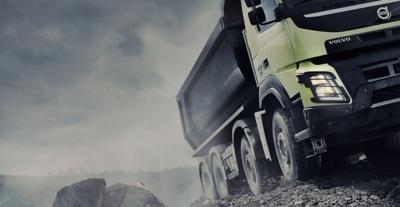 Volvo FMX tandem axle lift grey sky