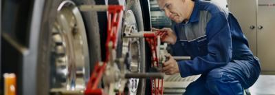 Technician checking wheel