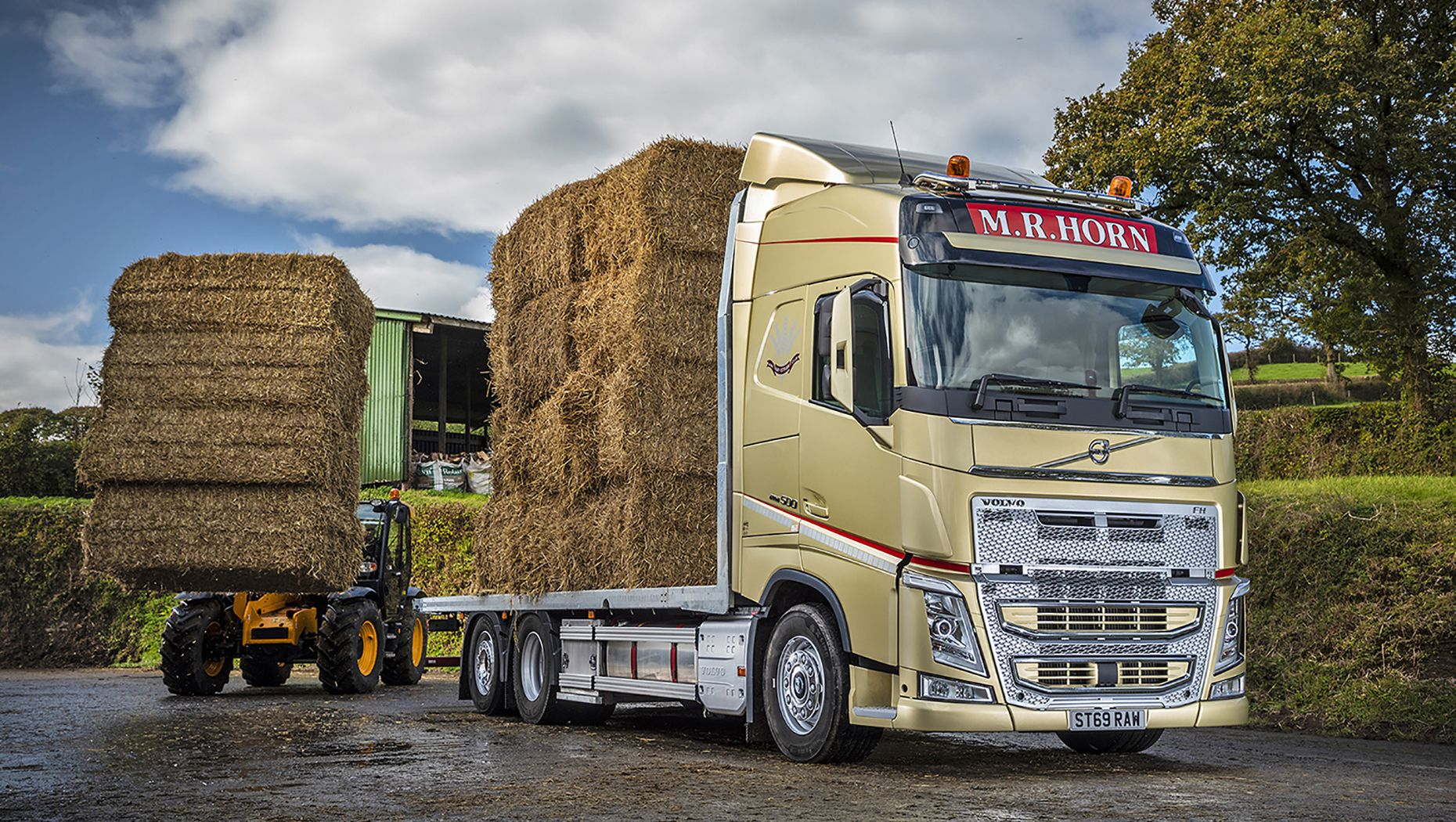 M.R. Horn makes hay and shines with a new gold liveried Volvo FH drawbar combination